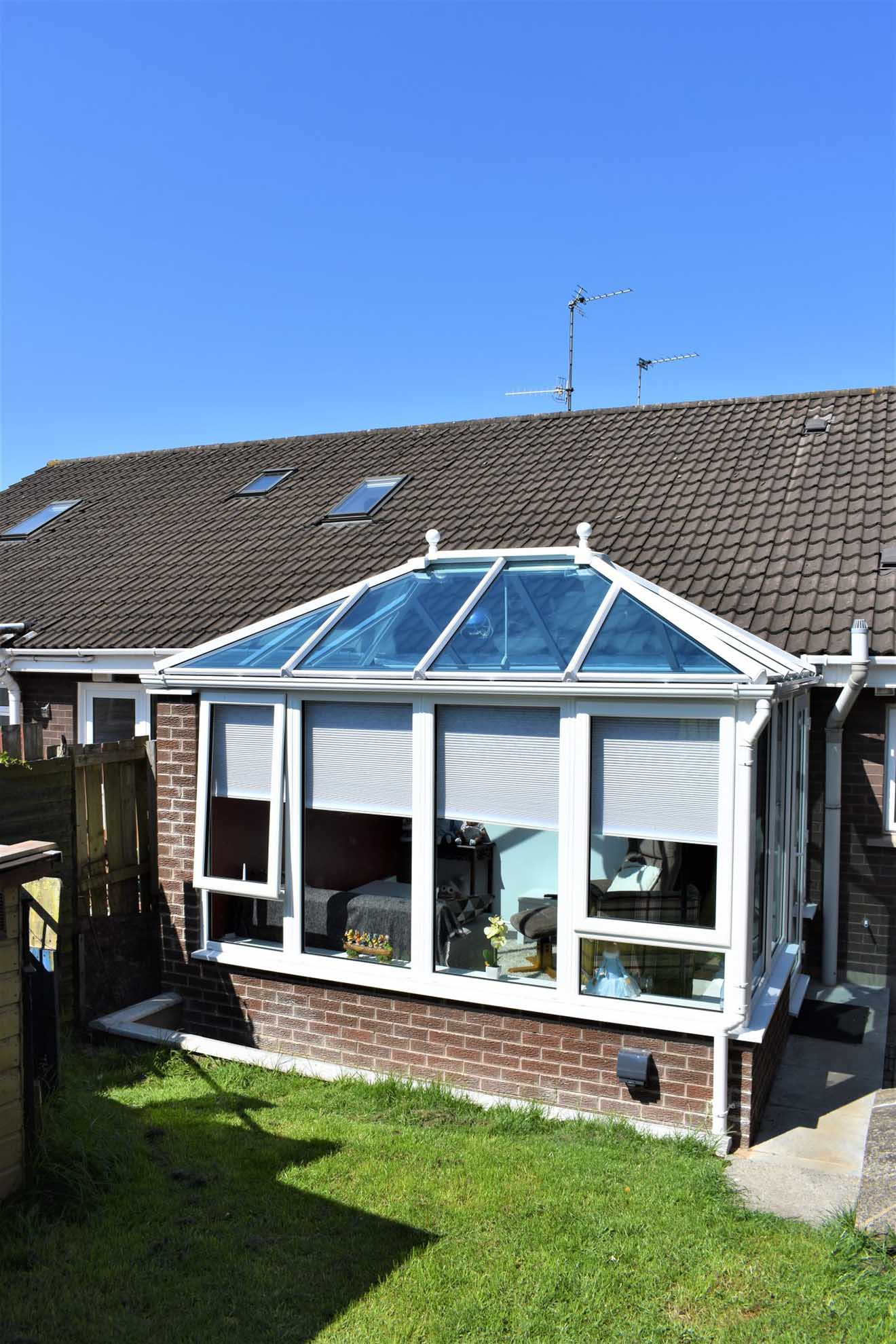 Glass roof conservatory pitched